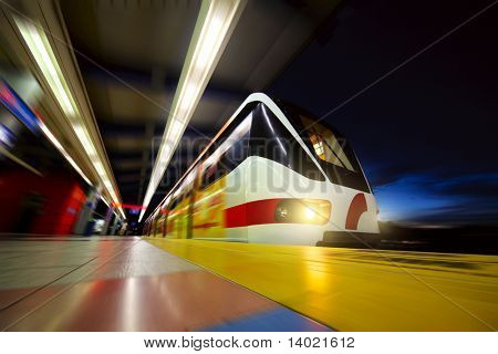 Motion blurred rapid train on station