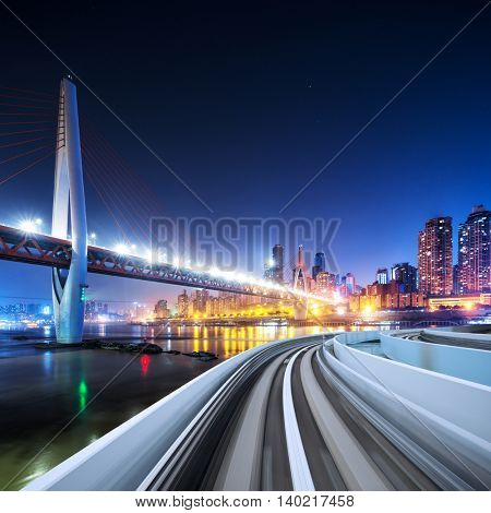 busy traffic on highway with cityscape and skyline of downtown near bridge of chongqing at night
