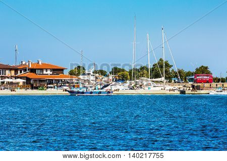 Nessebar, Bulgaria - July 25, 2016: Port, ships and old town view in Nesebar in Bulgaria
