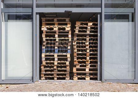 Stack of pallets blocking the door opening