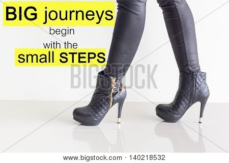 Word  Big Journeys Begin With The Small Steps.inspirational Motivational Quote On Black Leather Pant
