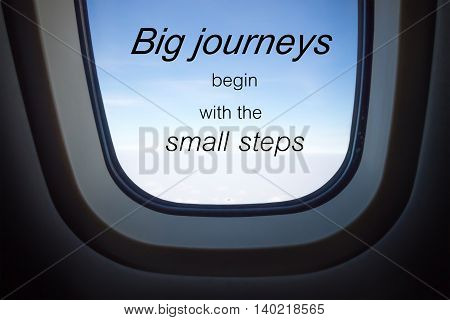 Word  Big Journeys Begin With The Small Steps.inspirational Motivational Quote On Plane Window Backg