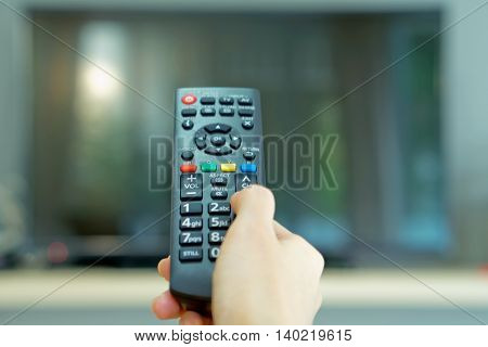 Watching TV and using remote controller, remote control