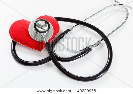 Red heart and a stethoscope. Healthcare and Medicine concept studio shot. On white background.