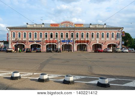 UGLICH RUSSIA - JULY 19 2016: Unknown people are near Hotel Uspenskaya (former building of trade rows) of old Russian town of Uglich. Shopping complex was built in late XVIII - early XIX century