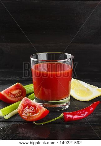 Bloody Mary With Celery, Lemon, Hot Pepper On A Dark Background