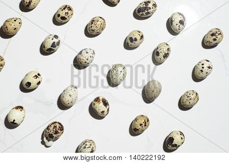 Group of quail eggs on the white background.