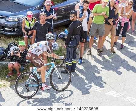 Col du Glandon France - July 23 2015: The Belgian cyclist Jan Bakelants of AG2R La Mondiale Team riding in a beautiful curve at Col du Glandon in Alps during the stage 18 of Le Tour de France 2015.
