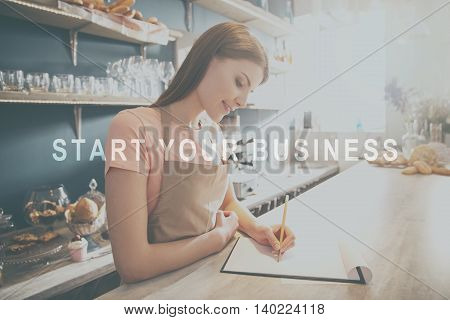 Growing potential. Inspiration words on image of smiling young women making notes in modern bakery background