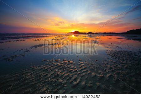 Sunset over beach during ebb