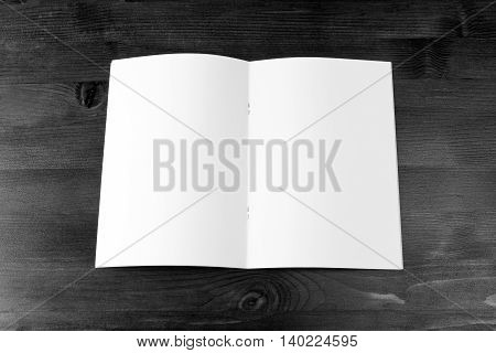 Blank catalog brochure book mock up. Empty opened magazine on wooden background