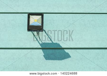Shade Of Illumination Lamp On Green Wall Outside