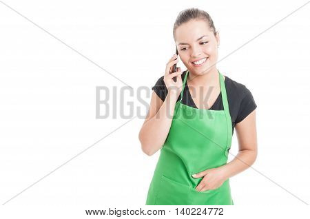 Happy Female Employee Smiling And Talking On Smartphone