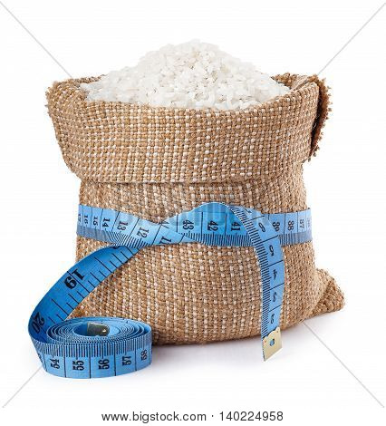 Rice. Grains of rice in burlap bag isolated on white background. Concept healthy diet food. Lose weight. Fitness food