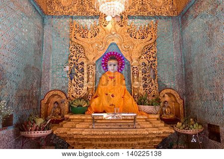 Buddha statue in a beautiful temple. Buddha statue in a niche ,Myanmar or Burma.