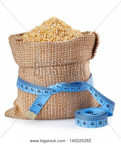Wheat groats. Grains of wheat in burlap bag isolated on white background. Concept healthy diet food. Lose weight. Fitness food