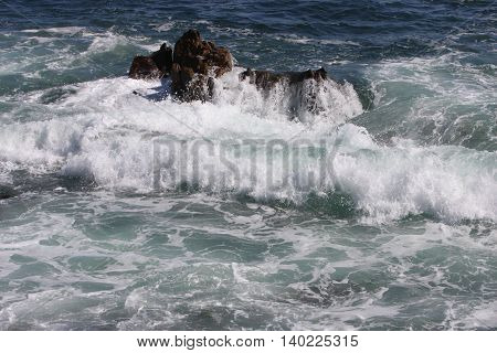This is an image of the rocky coastline of Point Lobos State Preserve located a few miles south of Carmel By The Sea in California, U.S.A.