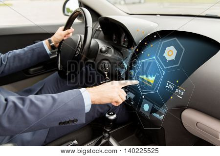 transport, business trip, modern technology and people concept - close up of man driving car and pointing finger to diagram on board computer screen