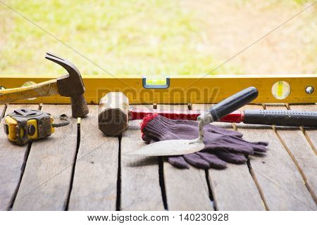 Masonry tool background such as glove and tape measure and sledgehammer with trowel and level and etc.Background for craftsman tool or background for building.