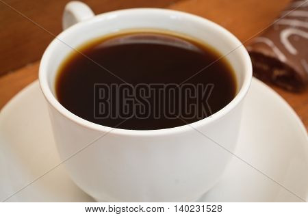 cup of coffee on a wooden table closeup