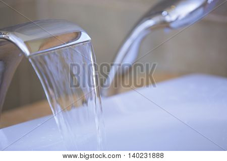 Close-up view of the tap with flowing water
