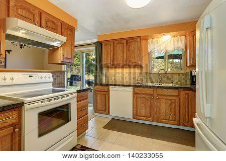 Light Tones Kitchen Room Interior With White Appliances.