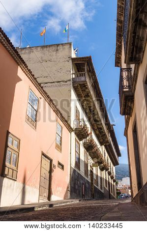 TENERIFE SPAIN - January 20 2016: Upward street with La Casa de los Balcones - historic house and a museum in La Orotava town. It was first built in 1632.