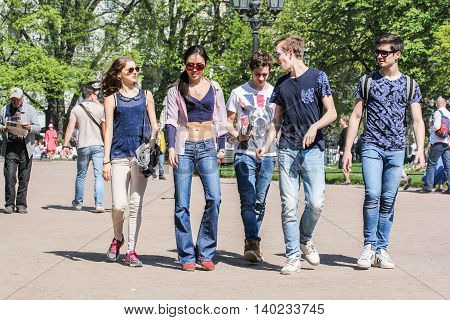 St. Petersburg, Russia - 9 May, Group of young people in the garden, 9 May, 2016. Vacationers people on the lawns and gardens in the city.
