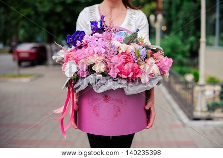 Beautiful tender purple bouquet of flowers in pink box