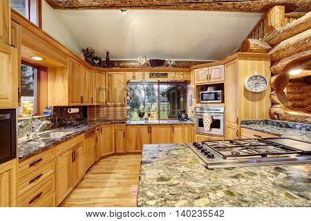 Log Cabin Kitchen Interior Design With Large Storage Combination