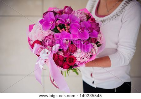 Beautiful bouquet of pink flowers in hands