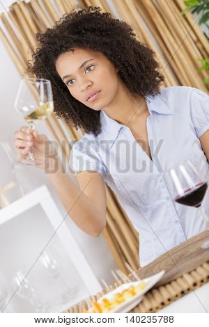close up of young beautiful woman raise a glass