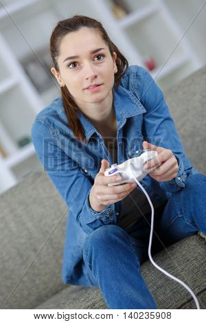 girl playing video game in room