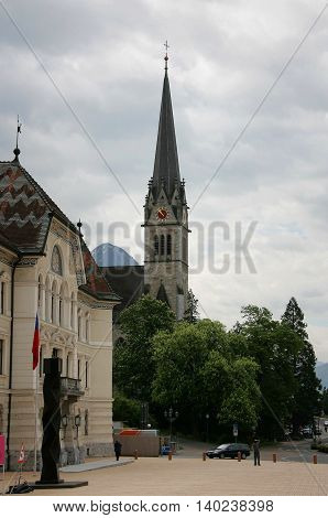 VADUZ LIECHTENSTEIN - MAY 06: The square in front of town hall background Cathedral on May 06 2009 in Vaduz Liechtenstein.
