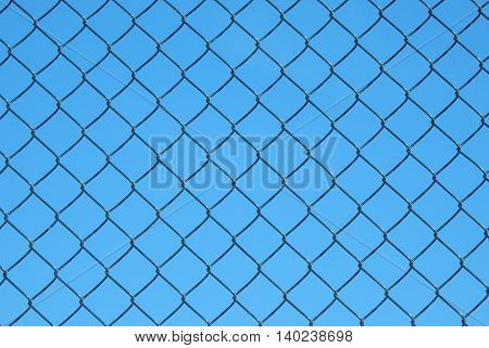Wire mesh steel with blue sky background