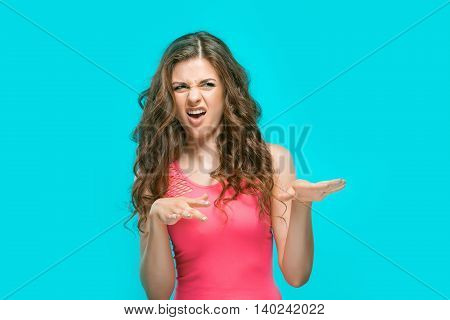 The portrait of disgusted woman on blue background