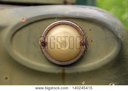Close-up view of a headlight of an old soviet truck