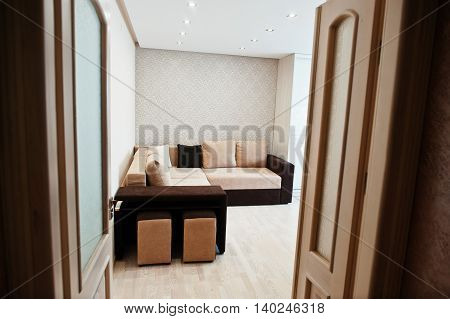Bicolor Cofee Corner Sofa Bed At Light Room