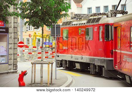 Chur Switzerland - June 07 2010: Passenger train moves on the city street to Arosa.