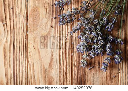 Dry lavender flowers on wooden background