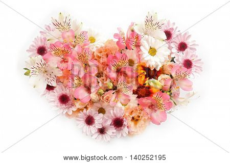 Composition of beautiful flowers in a heart shape on white background