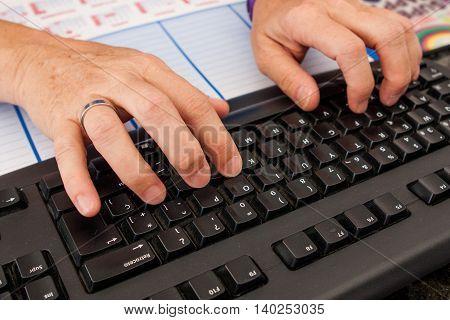 clerk keyboarding on computer keyboard in office