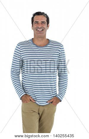 Portrait of happy mid adult man standing against white background