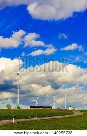 Renewable Energy Windmill Turbines in countryside, Luxembourg.