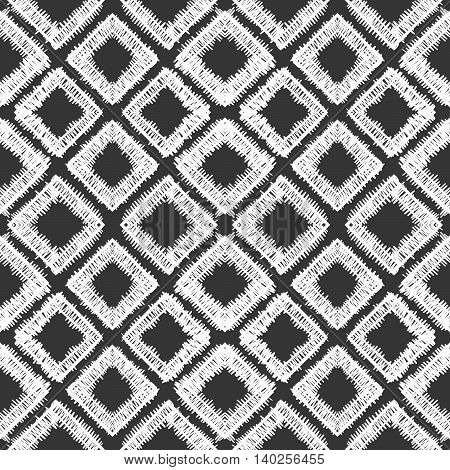 Abstract seamless hand drawn pattern of white scribble rhombs on black background.