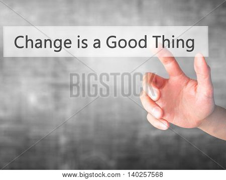 Change Is A Good Thing - Hand Pressing A Button On Blurred Background Concept On Visual Screen.