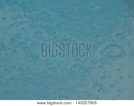 Perspective of Blue Swimming Pool Water Surface with Small Bubbles