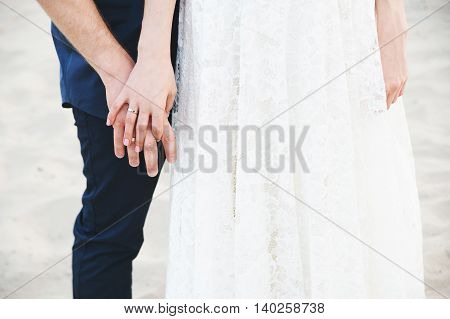 wedding hands in a wedding rings always together