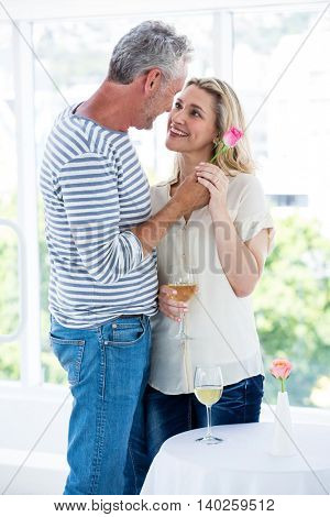Romantic mature couple standing face to face at restaurant