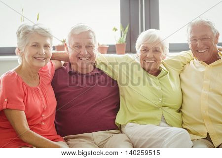 Seniors sitting together in a retirement home